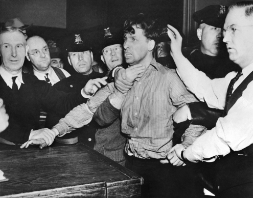 Percy Geary, a member of the Rubel heist gang, is seen here after his arrest on a previous kidnapping charge. He was named but never charged in the armored car robbery but went to Alcatraz for the kidnaping. The New York Times. Percy Geary, last of the three escaped members of the O'Connell kidnap gang, as he was brought into headquarters at Syracuse, N.Y., Nov. 18 after his capture. His capture followed that of his two cronies, John Oley and Harold Crowley, on Nov. 17. The trio escaped from Onondago County Prison two days ago. 11/18/1937 NYTCREDIT: Associated Press